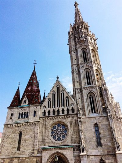 Religion Place Of Worship Spirituality Architecture Building Exterior Low Angle View Built Structure Rose Window Clear Sky Tower Sky Outdoors Day No People Bell Tower Travel Destinations