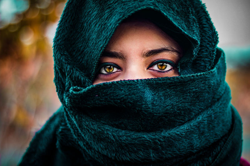 Close-Up Portrait Of Woman With Face Covered By Scarf
