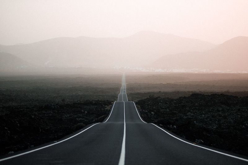 Always straight ahead Canary Islands Fuerteventura Dessert Mountain Range EyeEm Best Pics EyeEm Nature Lover Beautiful Nature EyeEm Best Shots Roadtrip Transportation Road Diminishing Perspective The Way Forward Direction Symbol Road Marking Landscape Marking vanishing point Environment No People Tranquility Nature Sign Fog Scenics - Nature Sky Country Road Outdoors My Best Photo The Traveler - 2019 EyeEm Awards The Great Outdoors - 2019 EyeEm Awards The Minimalist - 2019 EyeEm Awards
