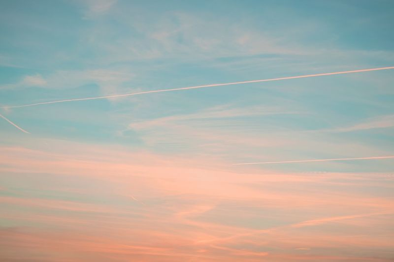 Vapor Trail Contrail Beauty In Nature Low Angle View Nature Scenics Sky Majestic Cloud - Sky Sunset Tranquility Sky Only Tranquil Scene Outdoors No People Blue Multi Colored Day The Great Outdoors - 2017 EyeEm Awards