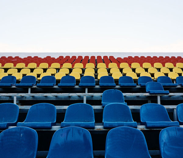 Auditorium Blue Chair Conformity Day Empty Folding Chair In A Row Large Group Of Objects No People Outdoors Seat Stadium The Week On EyeEm