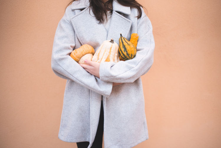 Autumn Mood Colored Background Holding Studio Shot Food Food And Drink Bathrobe Wellbeing Robe Healthy Eating Indoors  One Person Healthy Lifestyle Standing Women Fruit Adult Casual Clothing Towel Orange Color Tray Beige Background Snack Orange Background