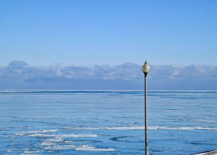 Close up view of lamppost over frozen Lake Michigan in Chicago during a frigid morning in January. Chicago Downtown Chicago Frozen Lake Lake Michigan Lake Michigan Chicago Lightpole Winter Beauty In Nature Blue Clouds Cracked Ice Day Frigid Frozen Water Horizon Over Water Lightpost Nature No People Outdoors Pole Scenics Sea Sky Tranquility Water