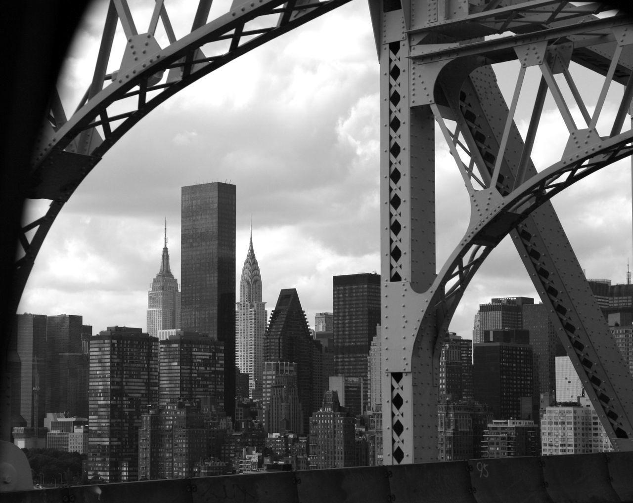 Metal Bridge Against Modern Buildings In City