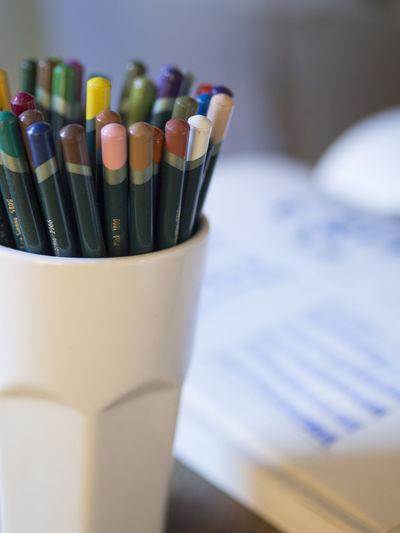 Close-up of pencils in desk organizer
