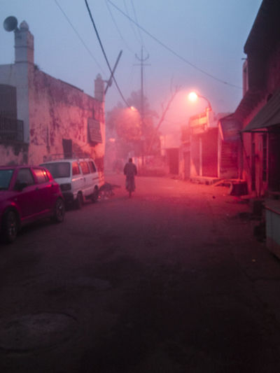 India Morning Light And Shadow Pink Color Transportation Mode Of Transportation City Land Vehicle Motor Vehicle Car Architecture Building Exterior Street Sky Built Structure Road Incidental People Nature Dusk Fog Illuminated City Life City Street Lamp