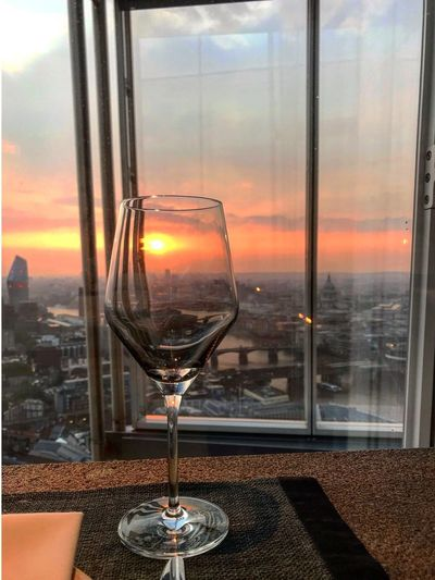 Close-up of glass of sunset