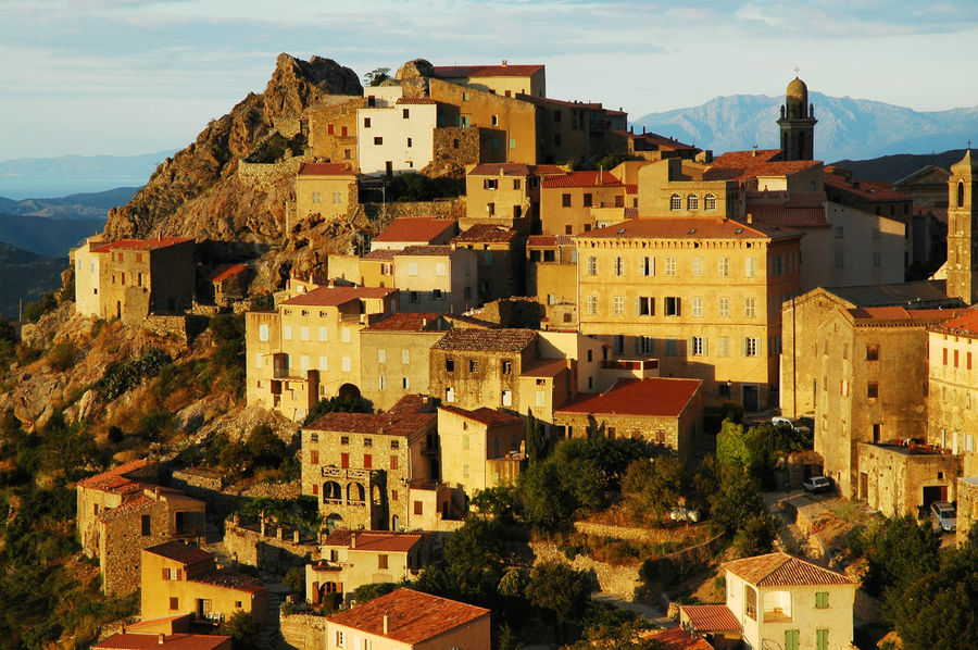 Late afternoon lights on a hill village. Speloncato, Corsica, France Afternoon Architecture Building Exterior Buildings Built Structure Church Corsica Corsican Destination France Hill Village Lights Mountain Mountain Village No People Outdoors Rocky Settlement Sky Speloncato Stone Houses  Sunset Travel Village Life Yellow