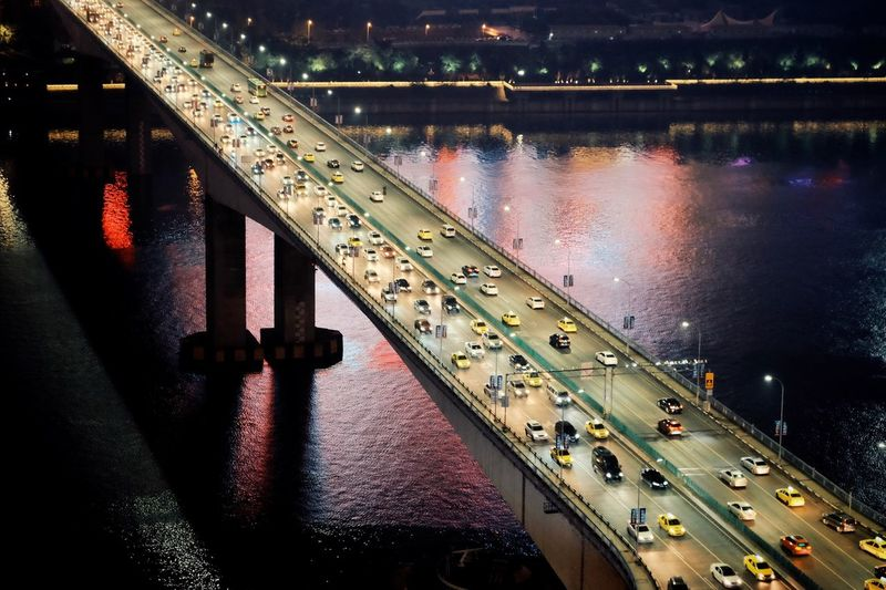 High angle view of bridge over river at night