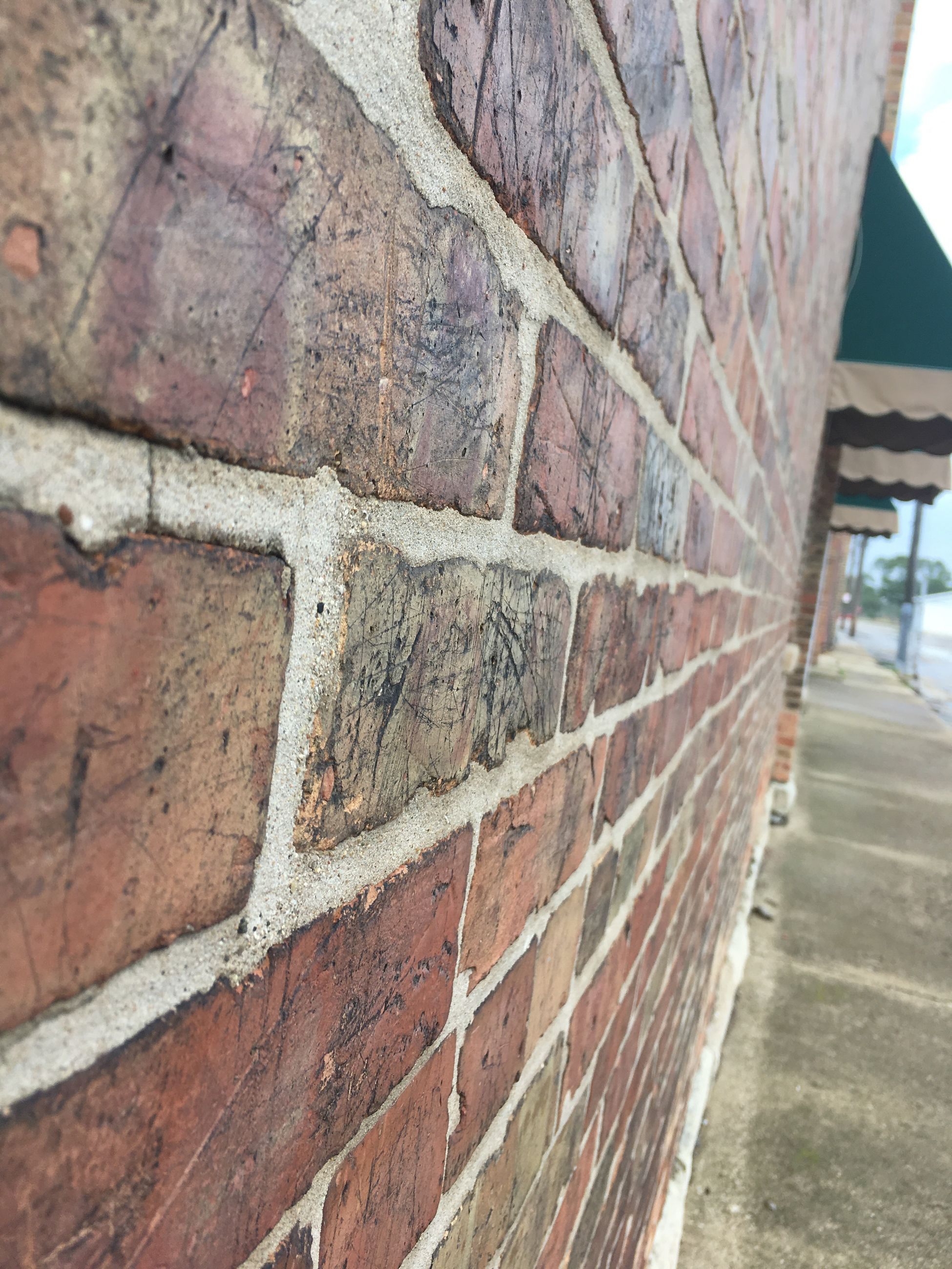 architecture, built structure, wall - building feature, building exterior, day, footpath, architectural feature, stone material, no people, pedestrian walkway