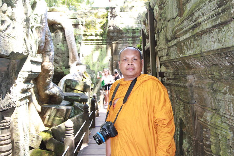 Portrait of monk with camera in temple