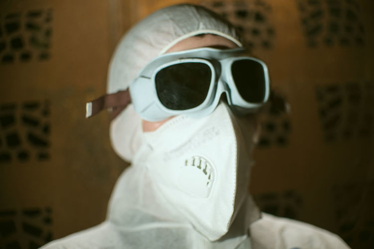 Portrait of man wearing protective goggles in laboratory