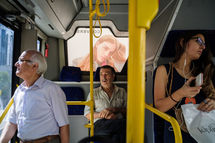 Man and woman sitting in bus