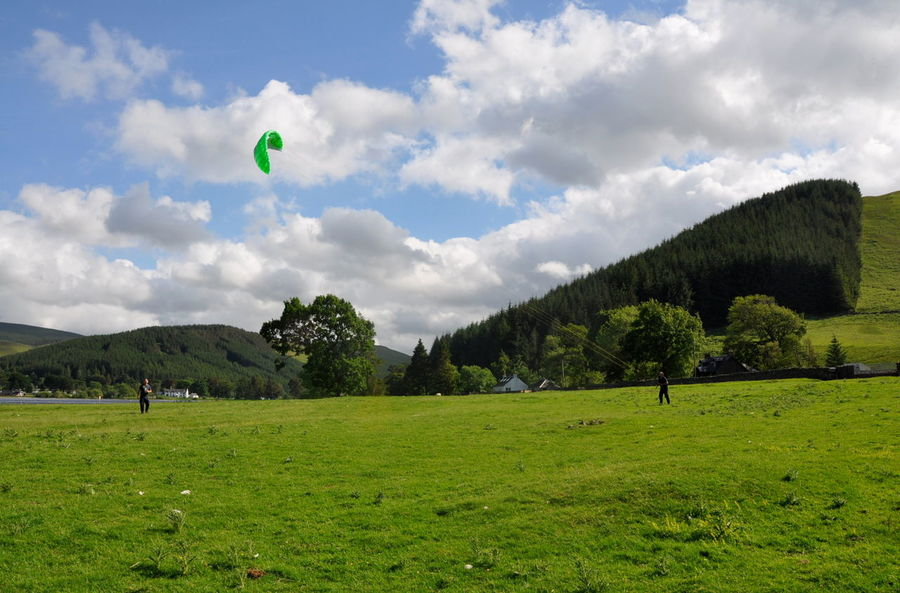 Grass Green Power Kiting  Activity Beauty In Nature Cloud - Sky Day Field Forest Grass Green Color Hobby Landscape Leisure Activity Nature Outdoors People Playing Real People Scenics Sky Sport Tree