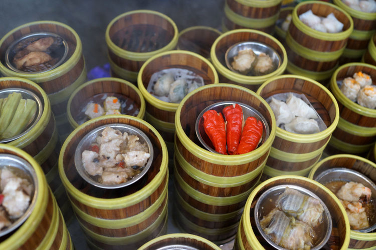 High angle view of dim sum in containers