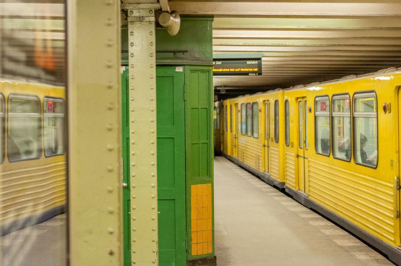 Yellow metro train at subway station