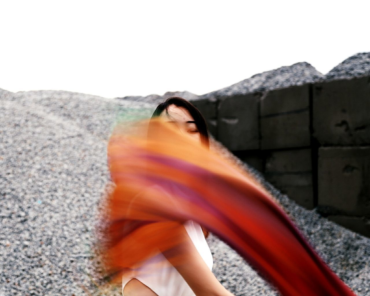 Blurred Motion Of Young Woman Dancing Outdoors