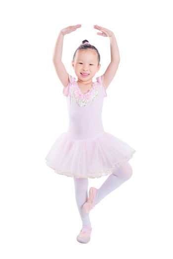 Ballet Isolated Girl Child Ballerina White Dancer Dance Little Background Young Kid Pink Cute Beauty Beautiful Happy Dress Childhood Dancing Female Portrait Studio Pretty Face Small Fun Sweet Adorable Children People person Art Fashion Smile Costume Happiness Cheerful Joy Standing Pose Preschool School Baby Color Asian  Thai Chinese Full Length