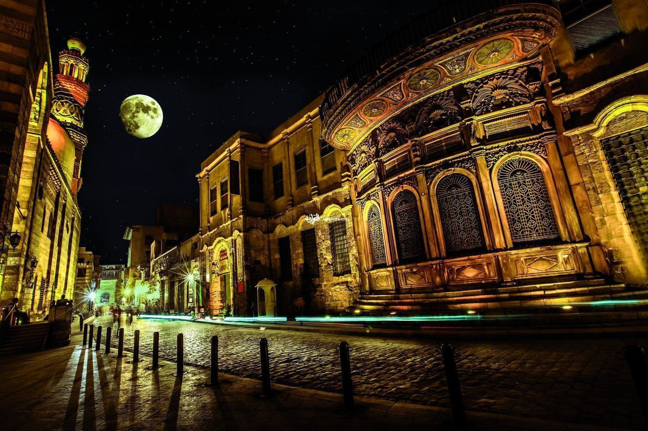 night, architecture, illuminated, built structure, building exterior, moon, building, city, no people, the past, travel destinations, history, low angle view, sky, reflection, lighting equipment, tourism, nature, art and craft, outdoors, nightlife