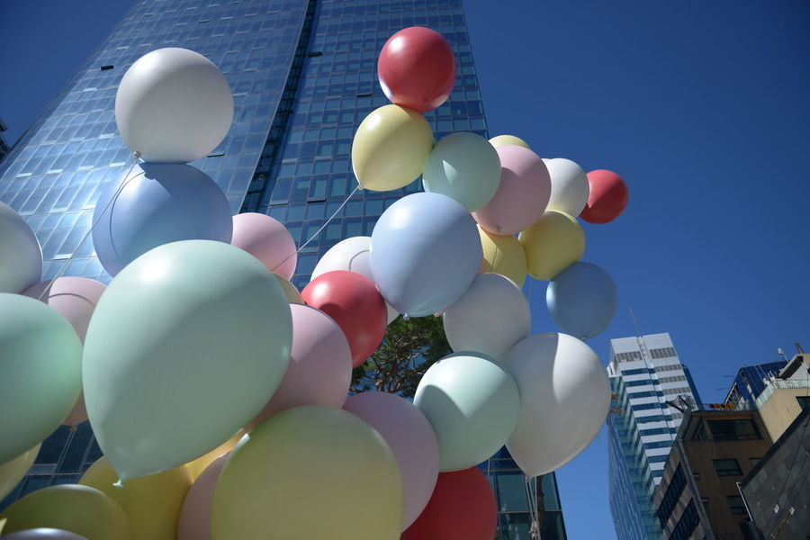Architecture Balloon Blue Building Building Exterior Built Structure Celebration City Clear Sky Day Helium Balloon Inflatable  Large Group Of Objects Low Angle View Mid-air Multi Colored Nature No People Outdoors Sky Sunlight