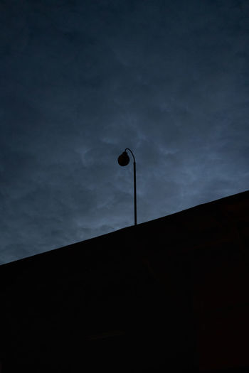Low angle view of street light against sky at night
