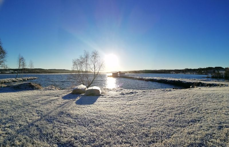 Beauty in Nature Storsjön Jämtland Sunlight Nature Natural Beauty Frosty Frost Clear Sky Sea Beach Sand Blue Protection Sky