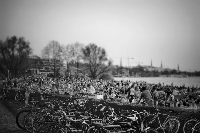 Summer Feeling in BNW Black And White Summer Views Crowd Of People Plant Sky Clear Sky Tree Nature Day Environment Landscape Real People Group Of People Bicycle Crowd Transportation Land Vehicle Responsibility Outdoors Field Land