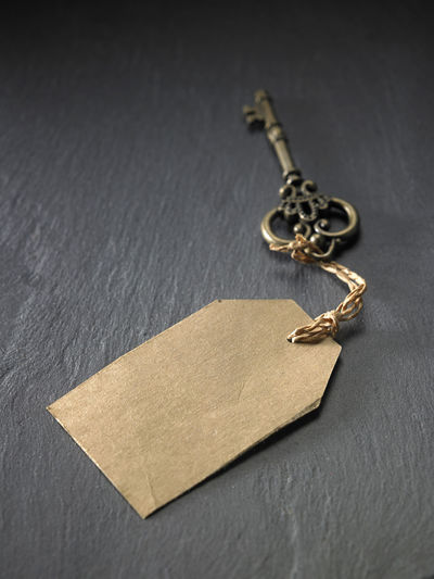antique key with tag Ancient Antique Copy Space Price Tag Retro Security Aged Blank Concept Decoration Key Label Lock Metal Tag Texture