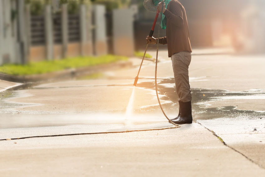 High pressure deep cleaning. Worker cleaning driveway with gasoline high pressure washer ,professional cleaning services. Adult Cleaning Cleaning Equipment Cleaning Services Day Driveway High Pressure Cleaner Jet Manual Worker Men One Person Outdoors People Professional Occupation Real People Spraying Water Young Adult