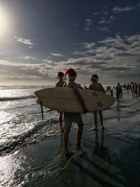 Surfing santas Surfing Santas Cocoa Beach, Florida Surf Board Surfers Santa Hat Lifestyles Friendship Beach Men Real People Beach Photography