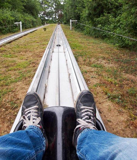Low section of man sitting on bobsled