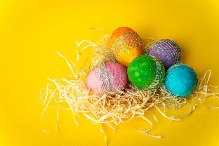 Easter time Easter Egg Eggs Art Eggs Spring Multi Colored Easter Yellow Celebration Easter Egg Holiday - Event Egg Close-up Animal Egg Eggshell Nest Egg Pastel Colored Yellow Background