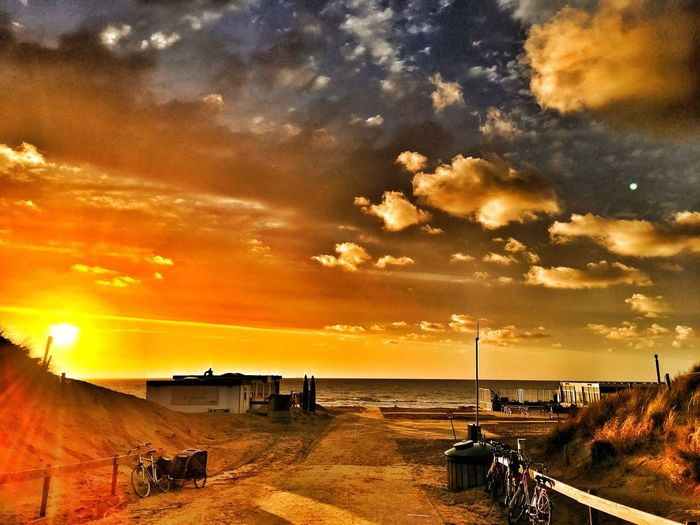 Cloud - Sky Sunset Sky Built Structure Scenics Dramatic Sky Architecture Building Exterior Nature Outdoors Tranquility Beauty In Nature Tranquil Scene Water Sea Road Horizon Over Water No People Day