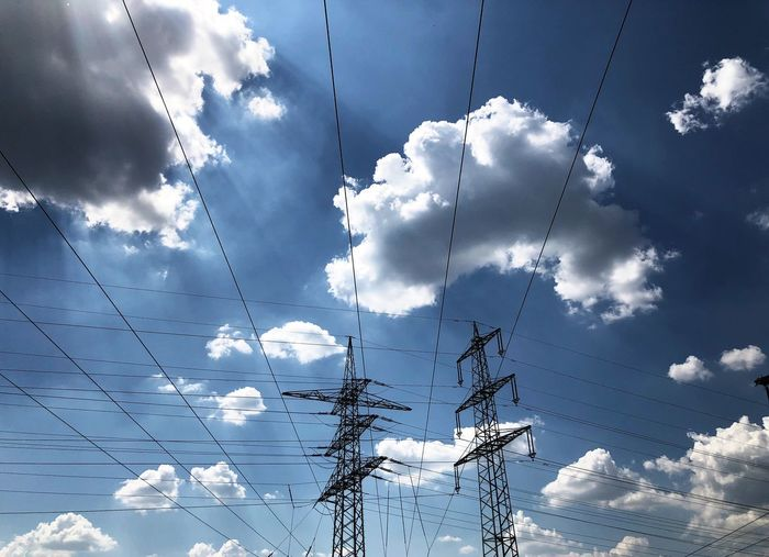 Electrical power against the sky Electricity  Technical Equipment Energy Industry Electrical Power Cloud - Sky Sky Low Angle View No People