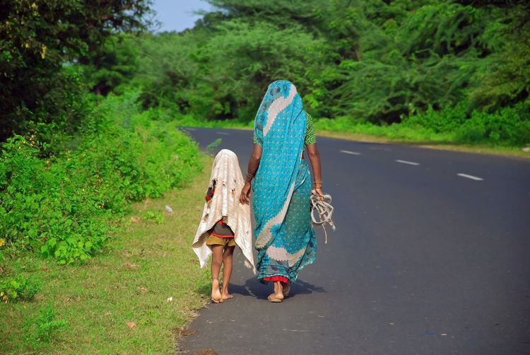women and her daughter are going towards the home after finished works at farm Clothing Nature Real People Road Women Walking Daughter Mother Child Mother And Daughter Rural India Rural People Indian People Lifestyle People Photography Working Out Poor  Rural Scene Tattered Cloth Kids Family Women Life Female Girl India