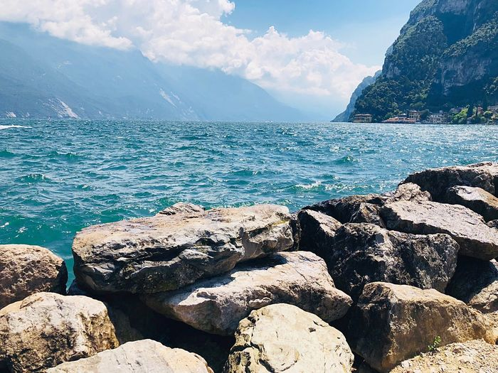 Italy Market Garda Mountain Water Beauty In Nature Nature Sky Sea Rock Solid Cloud - Sky Tranquility Beach Scenics - Nature Day Sunlight Rock - Object Land No People Outdoors Tranquil Scene