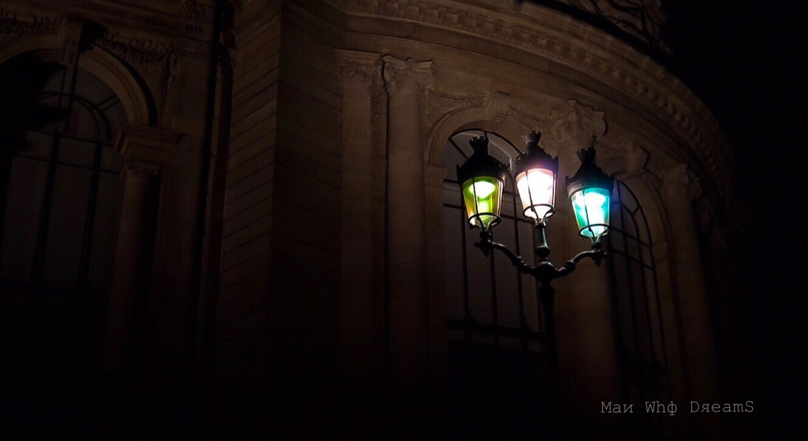 illuminated, architecture, lighting equipment, built structure, night, building, indoors, no people, low angle view, dark, arch, wall - building feature, place of worship, glowing, electricity, wall, text, light, electric lamp