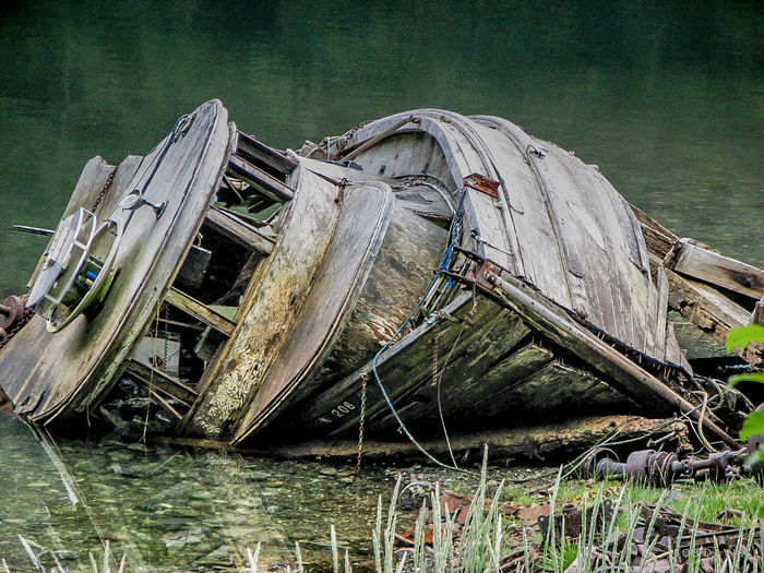 Final resting place... Abandoned Boat Damaged Day Fishing Boat Listing No People Non-urban Scene Obsolete Outdoors Scenics Shallow Water Skuttled Tranquil Scene Tranquility Water Waterfront Wooden Boat