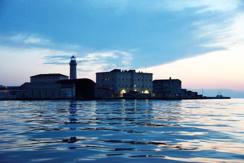 lanterna's lighthouse at the sunset Italy Lanterna's Lighthouse Lighthouse Maritime Photography Sea Sunset Travel Destinations Trieste Travel Pictures Summertime EyeEmNewHere Waterfrontview Urban Landscapes Neighborhood Map Colour Your Horizn