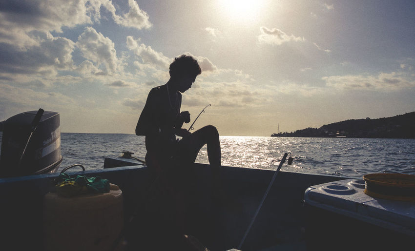 Trinidad And Tobago Caribbean Fishing Horizon Over Water Lifestyles One Person Outdoors Real People Sea Silhouette Sky Sunset Water
