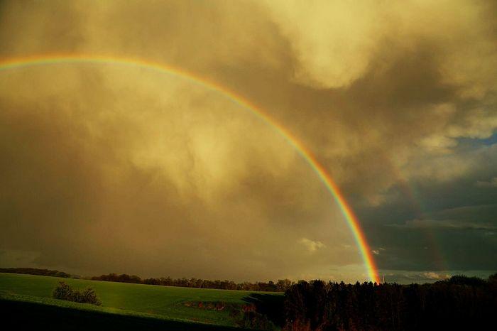Mammatus Clouds Mammatus Thundercloud Double Rainbow Rainbow EyeEm Nature Lover Nature Weather Landscapes Hugging A Tree