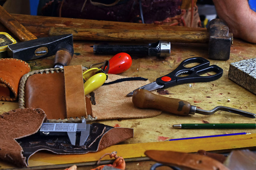 Leather craft working tools on the desk of workshop Art And Craft Creativity Desk Leather Working Art Choice Close-up Craft Equipment Hand Tool Handicraft Indoors  Job Leather Craft Leathercraft Occupation Table Tools Traditional Variation Work Tool Workbench Working Place Workshop Modern Workplace Culture Small Business Heroes