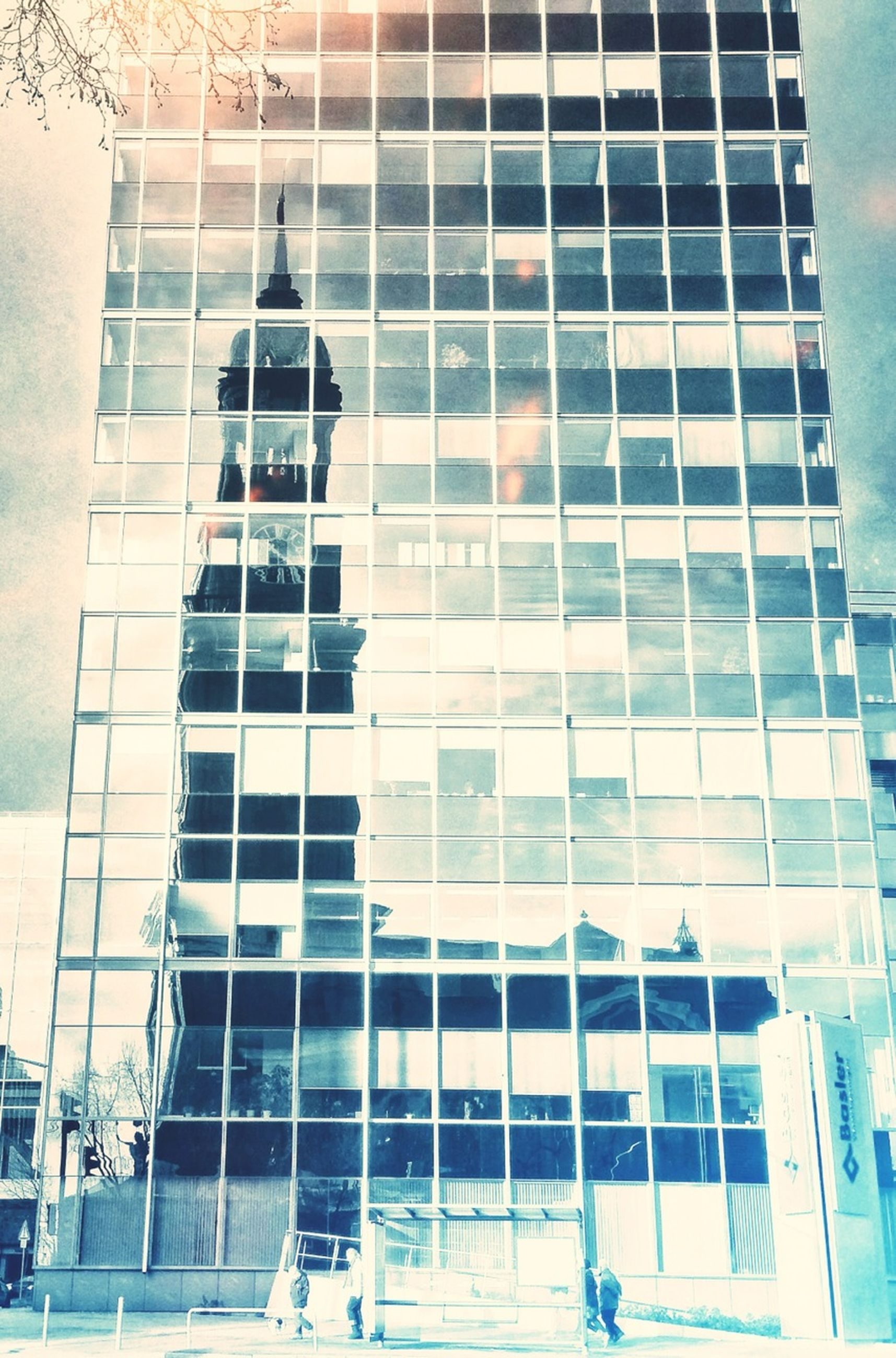 building exterior, architecture, built structure, modern, glass - material, office building, low angle view, reflection, building, window, city, skyscraper, tall - high, pattern, full frame, repetition, day, glass, backgrounds, outdoors