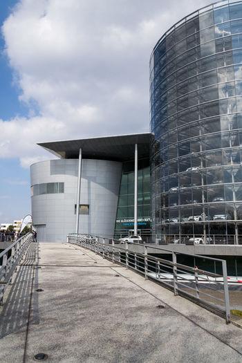Modern building against cloudy sky