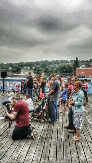 People Watching Riverside Taking Photos Relaxing