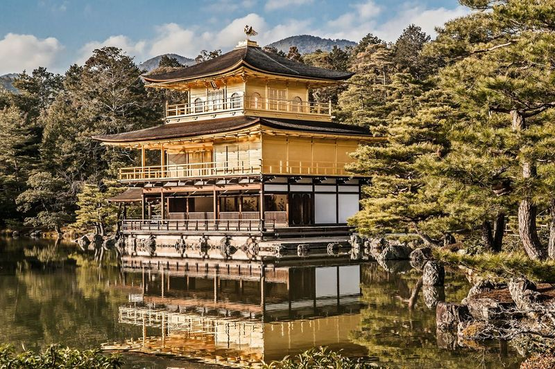 World heritage site Temple of the Golden Pavilion in Kyoto, Japan Ancient Buddhist Japan Kinkaku-ji Rehgarten-Tempel Rokuon-ji Temple Of The Golden Pavilion World Heritage Architecture Building Exterior Day Historic Kyoto Monument Nature No People Outdoors Sky Temple Traditional Building Tree Water Zen 金閣寺 鹿苑寺