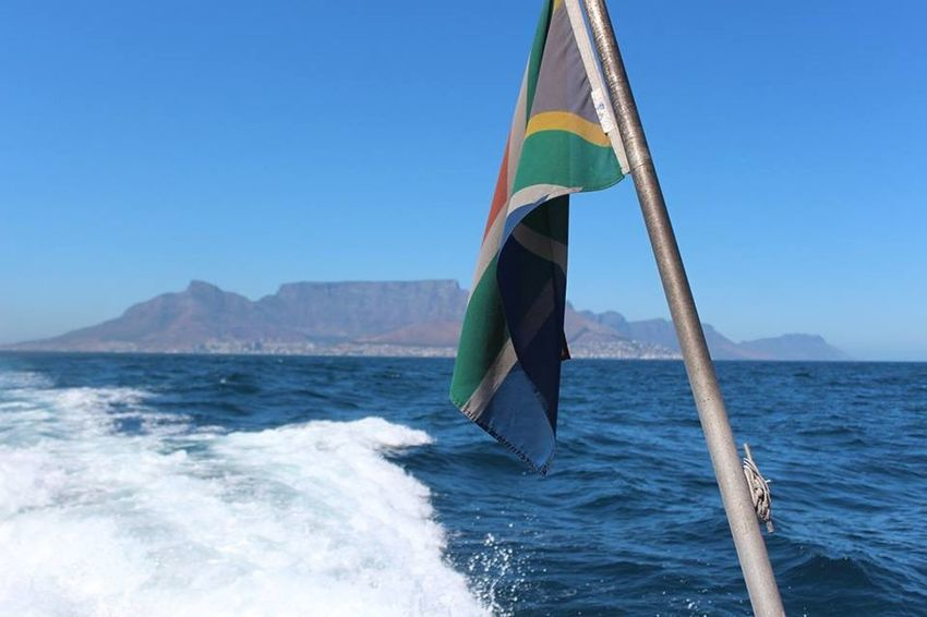 Boat trip to Robben Island, looking back at my beautiful home. South Africa Blue Day Flag Motion Mountain Nature Robben Island Sea Sky Sunlight Tranquil Scene Water Waterfront