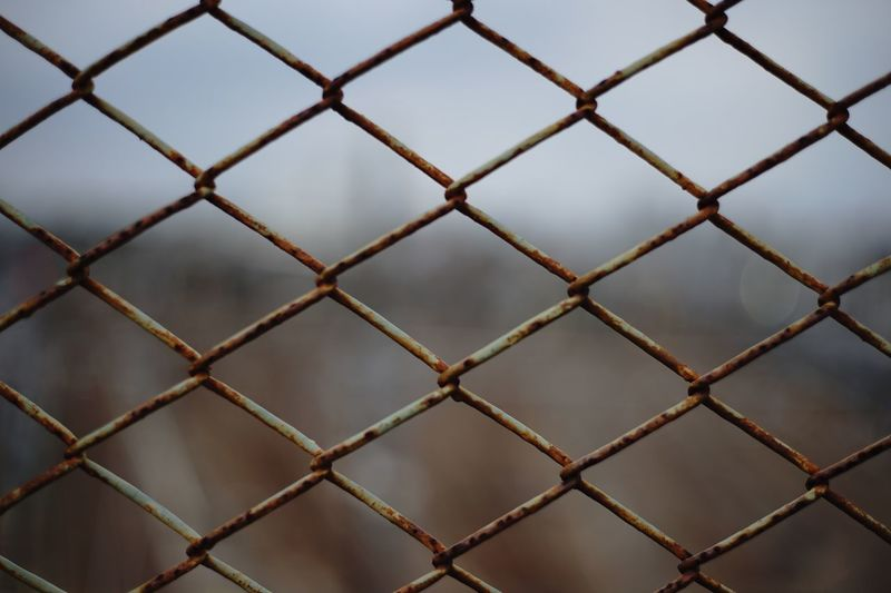 old Fence Chainlink Fence Full Frame Metal Pattern Boundary Barrier Safety Outdoors Focus On Foreground Close-up No People Day Repetition Nature Security Protection Backgrounds Order Crisscross
