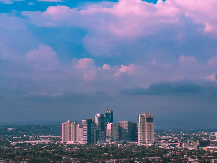 Ortigas Travel Artsofvisuals BestofEyeEm Earth Vivid Art Pink Color City Cityscape Urban Skyline Skyscraper Sea Sunset Modern Business Finance And Industry Downtown District Sky Office Building High Rise Infrastructure Skyline Building Tall - High Financial District