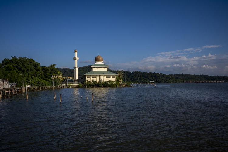 Kampung Pintu Malim Mosque located at Bandar Seri Begawan, Brunei Darussalam Water Sky Built Structure Architecture Building Exterior Waterfront Dome Religion Spirituality Belief No People Nature Travel Destinations Place Of Worship Travel Tourism Tree Lake Outdoors